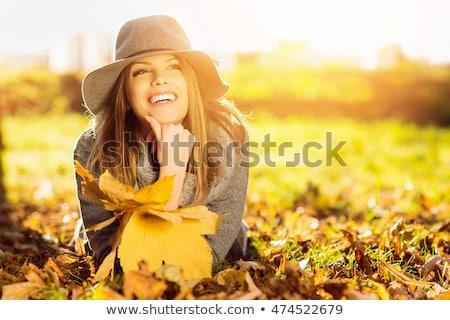 Közelkép hosszú hajú nyugodt nő park fű Stock fotó © photography33