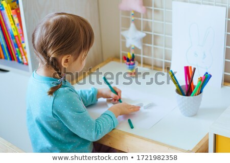 little girl focused on drawing a picture stock photo © stuartmiles