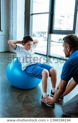 Doing Sit-Ups With Exercise Ball Stock photo © stuartmiles