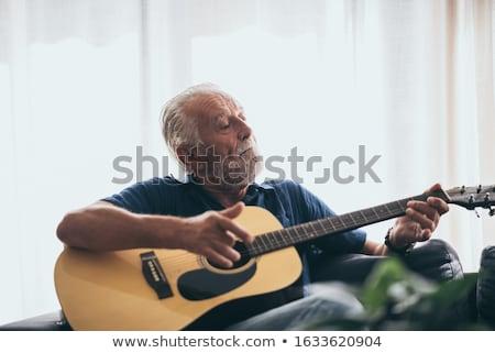Hombre guitarra rojo jugando concierto diversión Foto stock © leedsn
