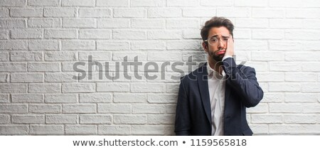 portrait of young businessman having remorse stock photo © photography33