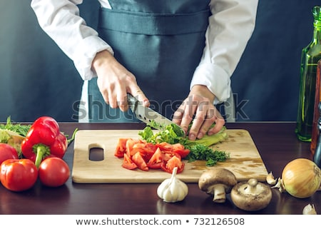 man cutting vegetables on a chopping board stock photo © photography33