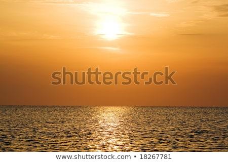 Narancs naplemente fölött csendes derűs öböl Stock fotó © acidgrey