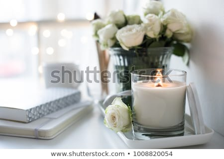 candle and roses  stock photo © vwalakte
