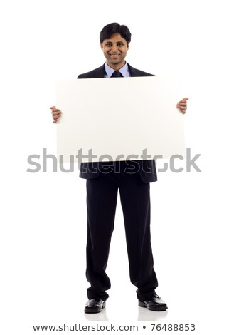 Indian business man showing blank space. Stock photo © szefei