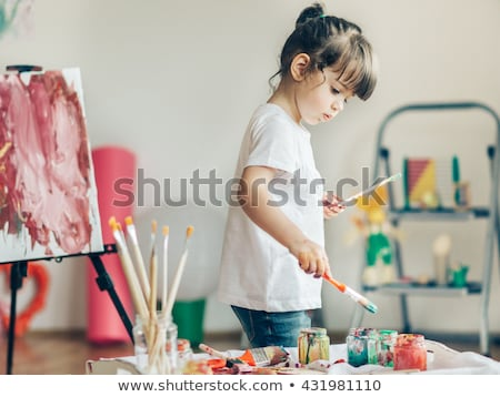 cute girl painting on small desk Stock photo © gewoldi