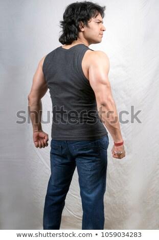 вид · сзади · молодым · человеком · глядя · стены · модель - Сток-фото © stockyimages