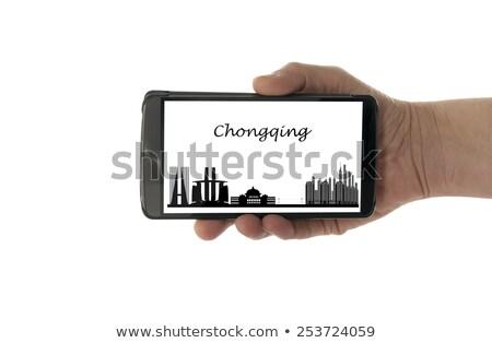 Kadın el cep telefonu ufuk çizgisi yalıtılmış beyaz Stok fotoğraf © compuinfoto