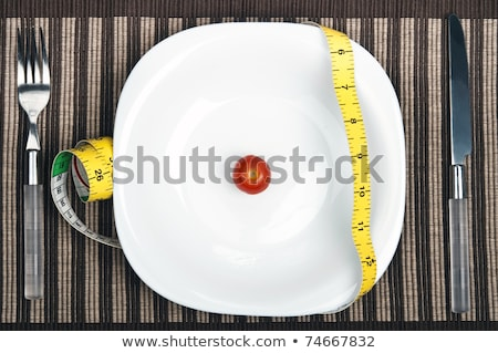 Cm ruler on food plate Stock photo © fuzzbones0