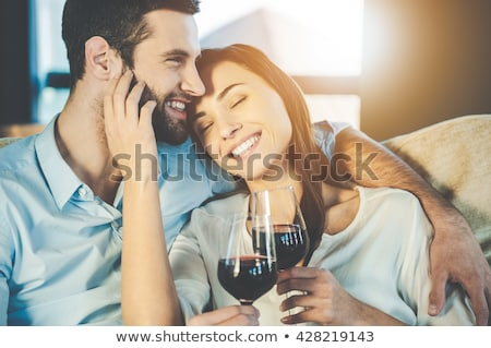 Fiatal pér élvezi vörösbor kanapé otthon nappali Stock fotó © wavebreak_media