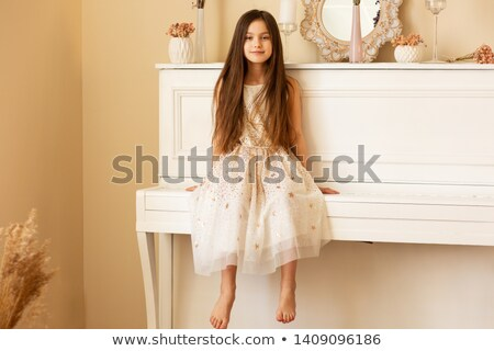 Back view portrait of a ballerina holding pointe shoes  Stock photo © deandrobot