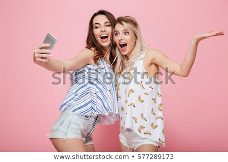 Happy young woman making selfie photo Stock photo © deandrobot