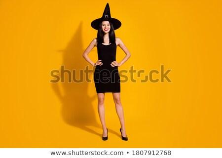 Bela mulher preto mini vestir boné Foto stock © filipw
