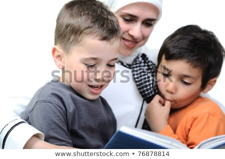 Mother Muslim and her son in the nature, reading together Stock photo © zurijeta