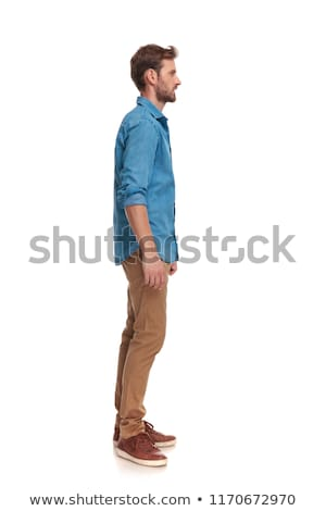side view of a smiling casual man waiting in line stock photo © feedough