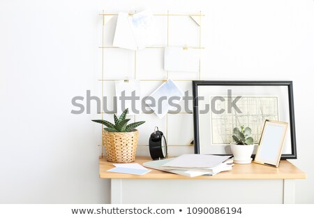 Working place at home with plants and moodboard Stock photo © dashapetrenko