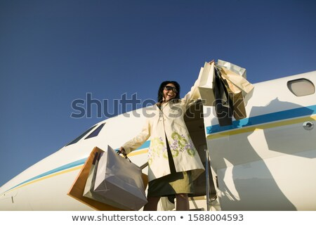 Smiling woman exiting private jet Stock photo © IS2