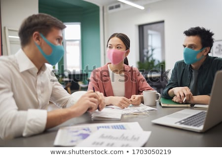 Business meeting of a group of doctors Stock photo © IS2