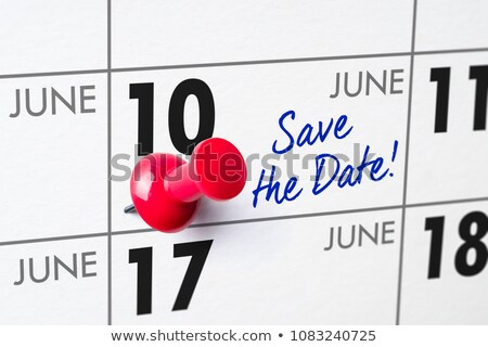 Wall calendar with a red pin - June 10 Stock photo © Zerbor