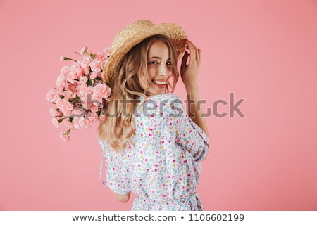 Attractive woman with a bouquet of beautiful flowers in her hands on a gray background Stock photo © artjazz