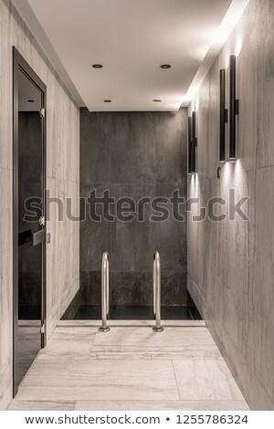 Black handle on glass door in luminous interior Stock photo © bezikus