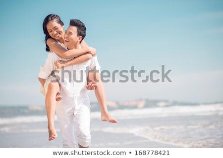 小さな 女性 ビーチ かなり 白いドレス サングラス ストックフォト © boggy