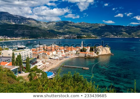 Old houses with red-orange roofs in Budva in Montenegro Stock photo © bezikus