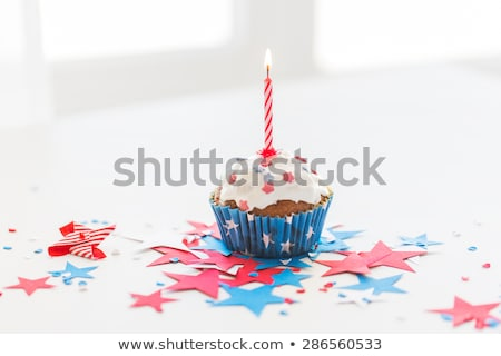 cupcake with candle on american independence day Stock photo © dolgachov