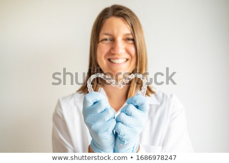 Young doctor with heart shape isolated on white Stock photo © Elnur