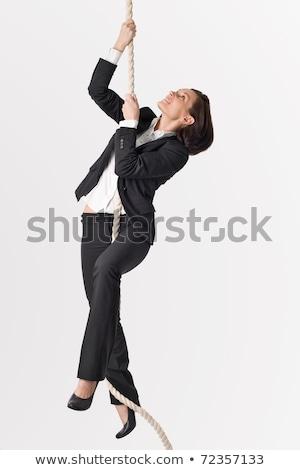 Donna impiccagione corda divertimento muscolare Foto d'archivio © Kzenon
