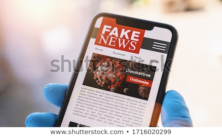 Man Holding Newspaper With Fake News Stock photo © AndreyPopov