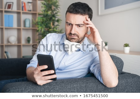 Man Reading Fake News Stock photo © AndreyPopov