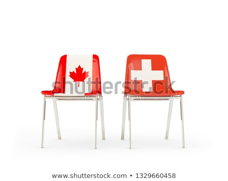 two chairs with flags of canada and switzerland stock photo © mikhailmishchenko