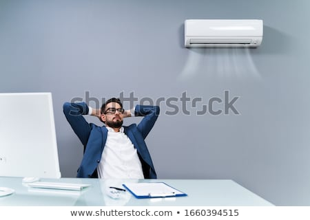 Businessman Relaxing In Office With Air Conditioning Stock photo © AndreyPopov