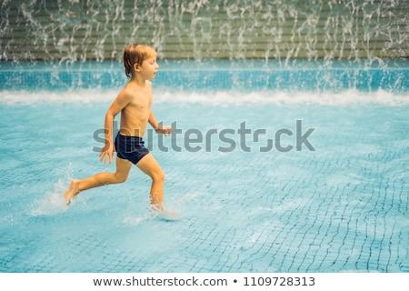 kicsi · fiú · szórakozás · úszómedence · égbolt · baba - stock fotó © galitskaya