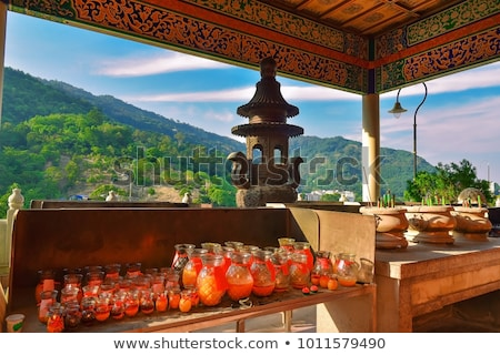 Candles in the Buddhist temple of Kek Lok Si in Malaysia Stock photo © galitskaya