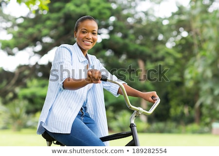 Woman Cycling in Park, Afro Lady Riding on Bike Stock photo © robuart