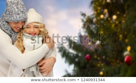 happy couple over christmas tree in tallinn Stock photo © dolgachov