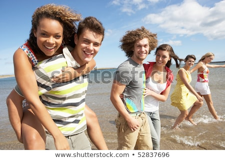 Group Of Young Friends Walking Along Summer Shoreline Stock photo © monkey_business