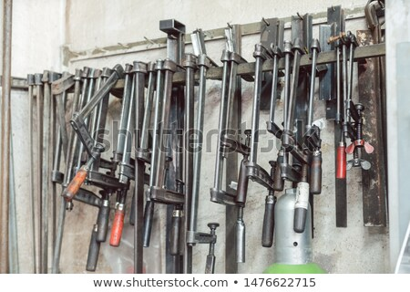 Bar clamps and other tools in metalworks workshop Stock photo © Kzenon