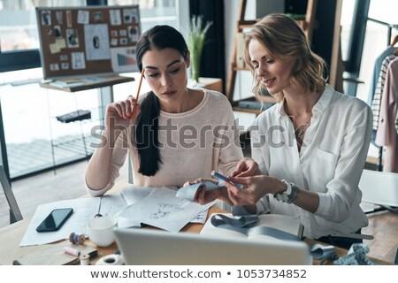 Two Young Creative Fashion Designers Looking At New Sketch Stock Photo C Dmitrii Shironosov Pressmaster 9960590 Stockfresh