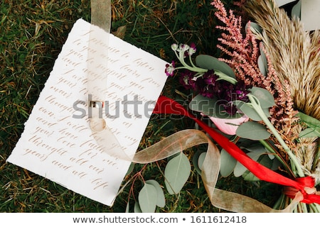 Wedding details flat lay. Wedding invitation and scroll paper. Bottle with fragrance. Ring box. Simp Stock photo © user_15523892