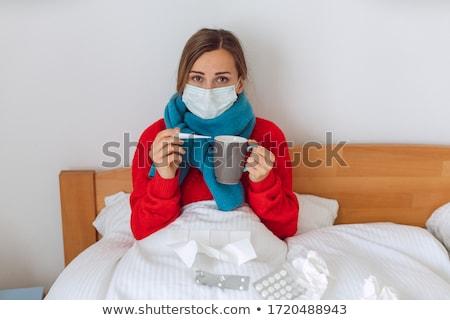 Mulher febre cama olhando preocupado Foto stock © Kzenon