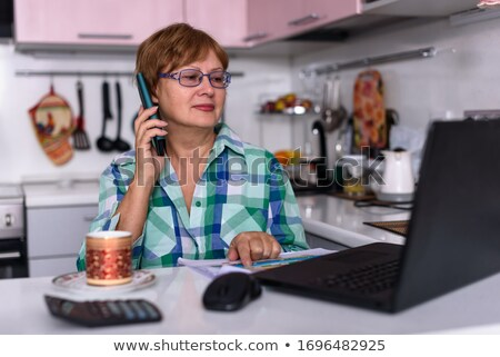 Woman on the phone in her office Stock photo © photography33