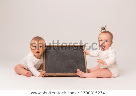 toddler holding sign stock photo © gewoldi