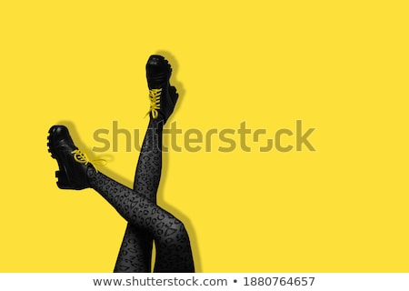 beautiful legs of young girl in tights and yellow shoes stock photo © pzaxe