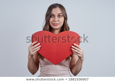 Woman with pink paper heart on her t-shirt Stock photo © stockyimages