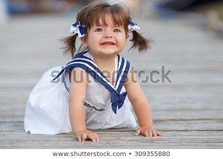 Little girl crawling on the floor stock photo © RuslanOmega