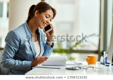 Happy business woman talking on the phone stock photo © dacasdo