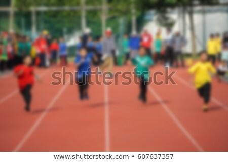 Mulher jovem corrida seguir campo estádio movimento Foto stock © lightpoet